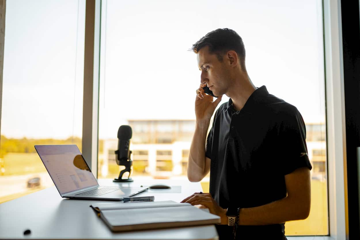 Photo of a salesman on a call.