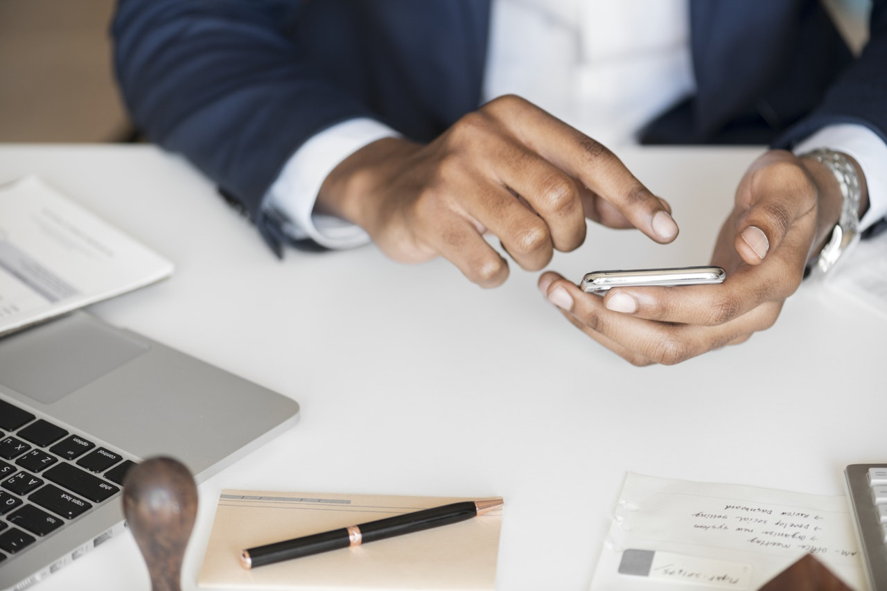 photo of a business person texting their personal assistant