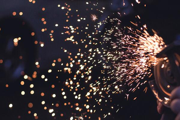 photo of sparks to represent the catalyzing effect of continuous improvement