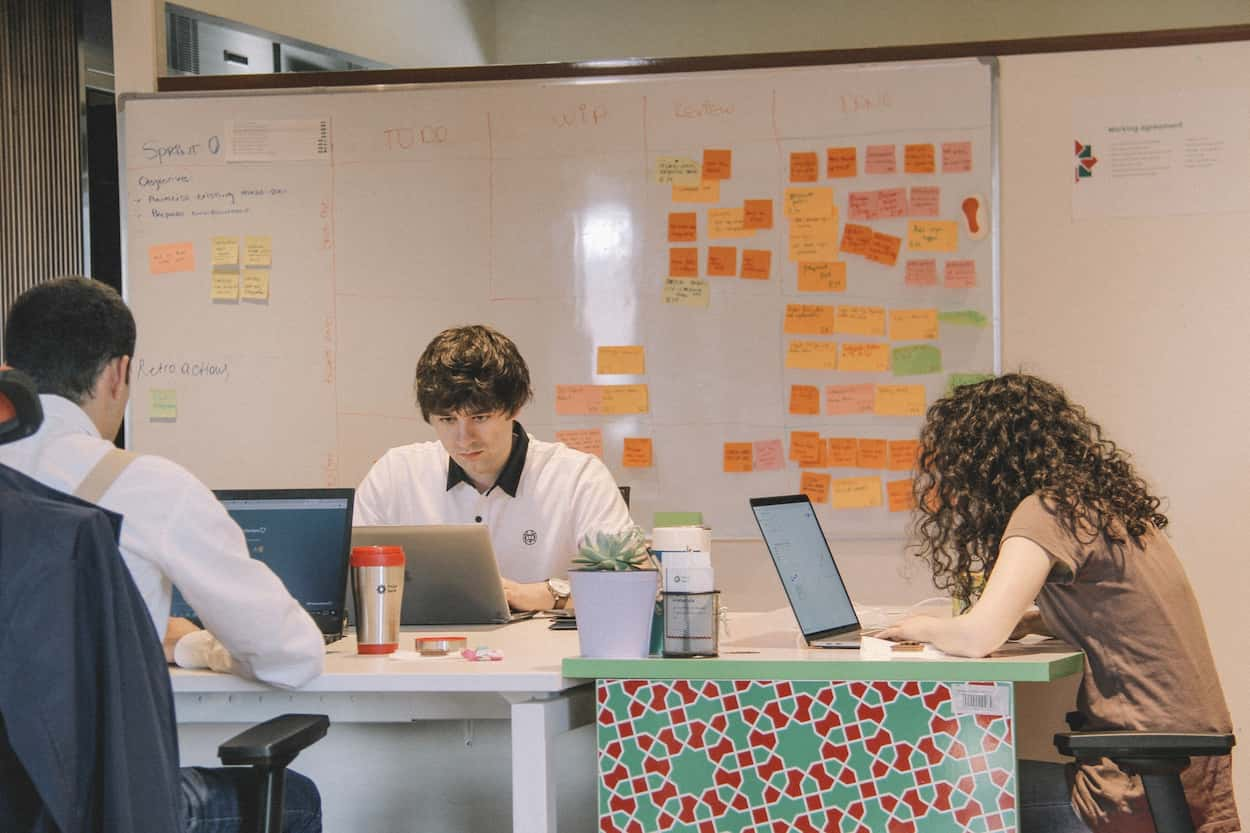 Photo of people working on a task management system.