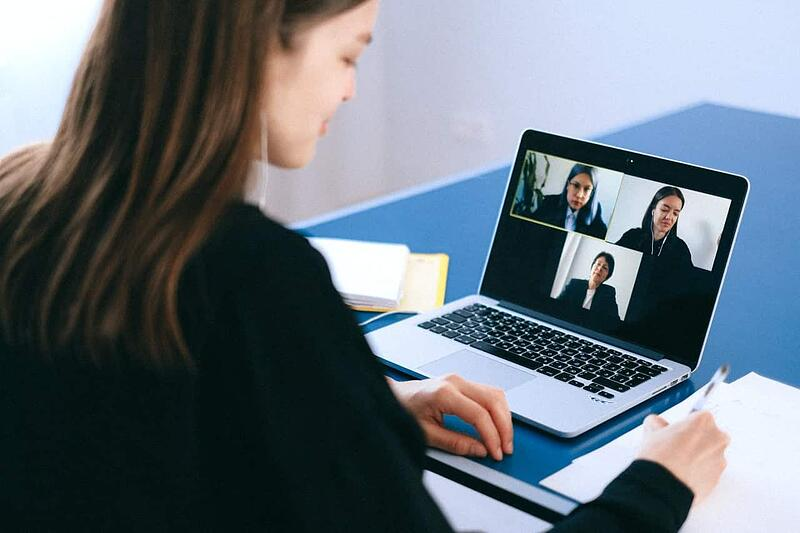 Photo of an executive having a video meeting.