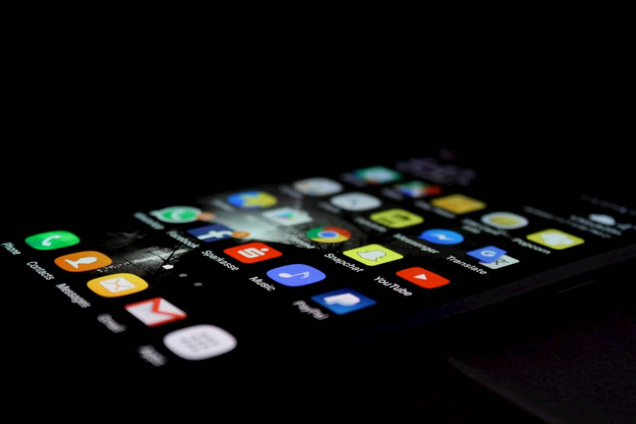 Photo of a smart phone screen filled with apps.