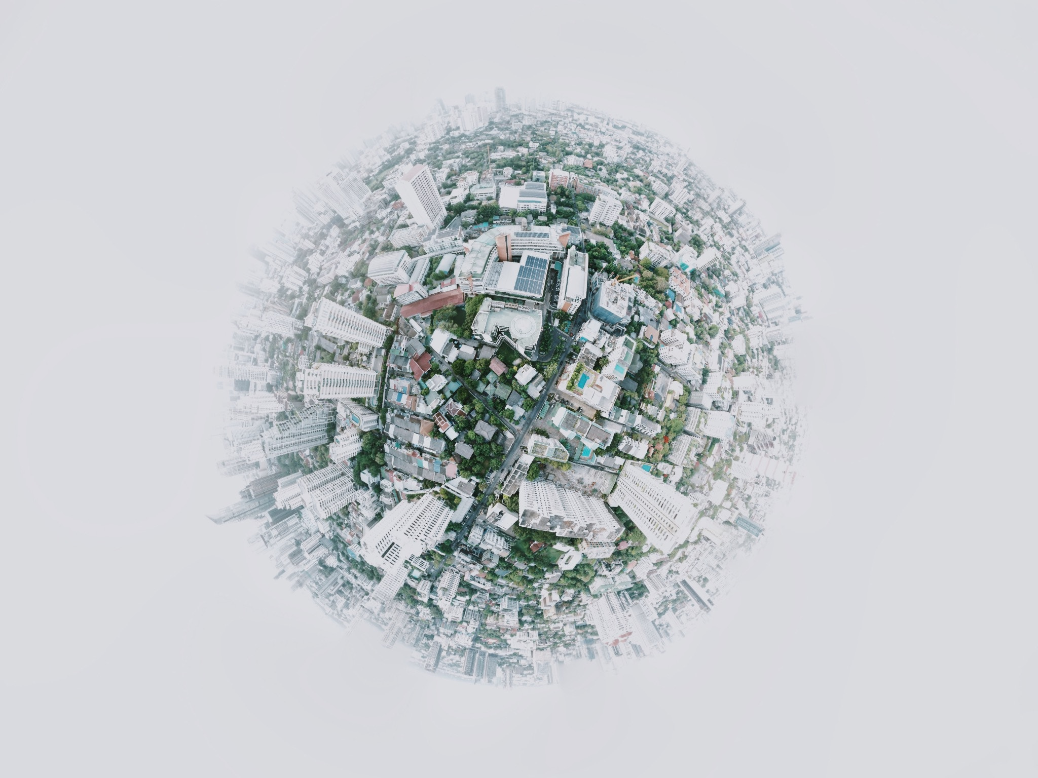 illustration of a globe with city buildings covering the entire thing. The photo is meant to represent how connecting the global workforce is.